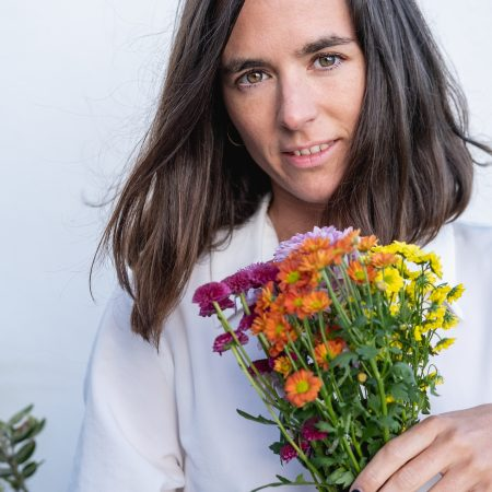 Leen S holding flowers - Sublime Life Coaching Erotic Boos!